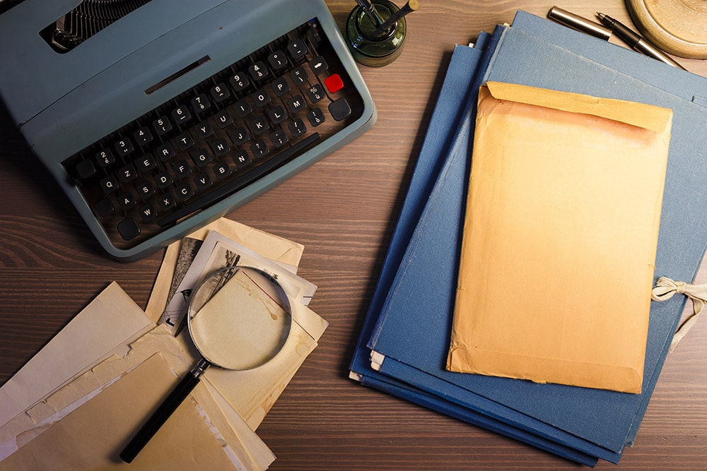 detective documents on a table