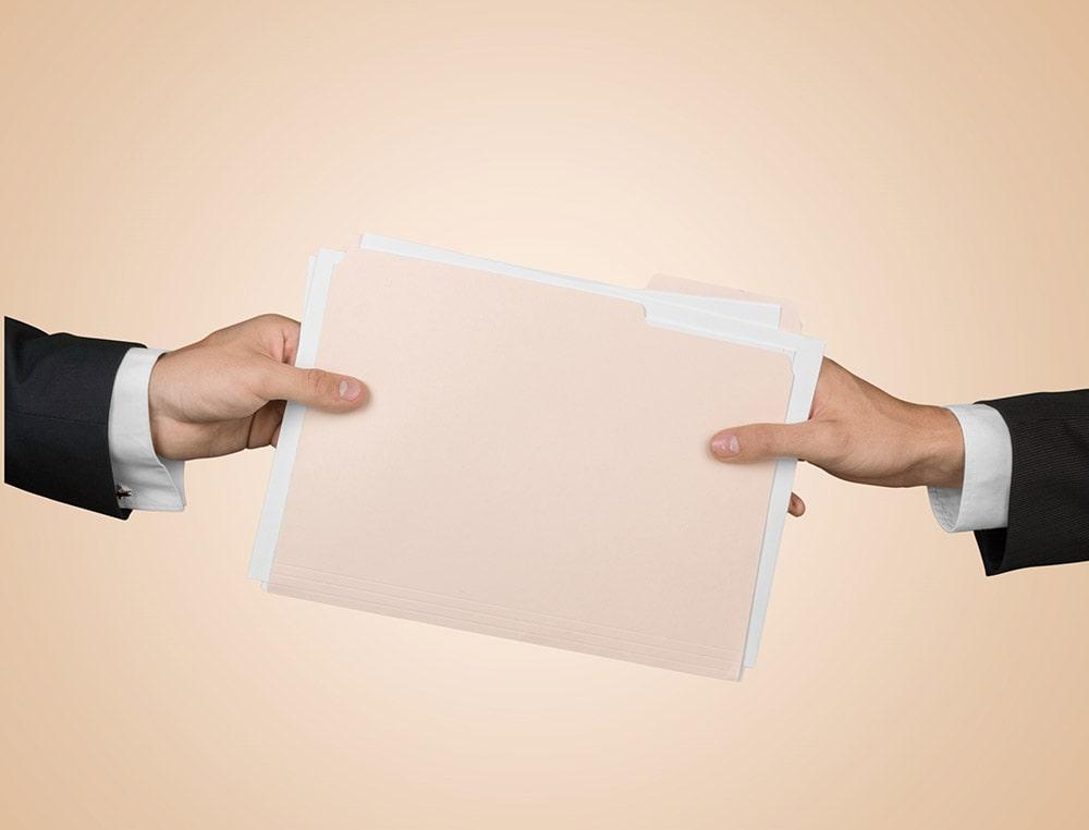 files being handed between two people